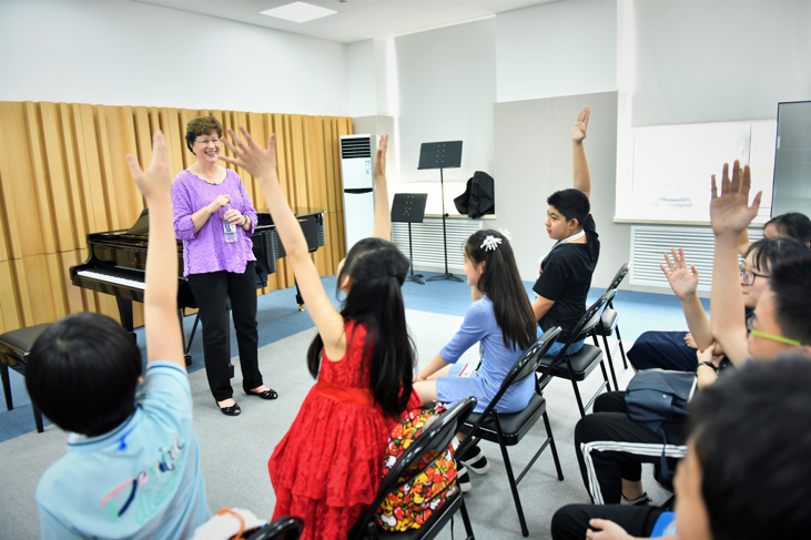 Juilliard's Pre-College artistic director and?pianist?Yoheved?Kaplinsky with the  Tianjin Juilliard Pre-College students in China. Photo credit: Duan Chao